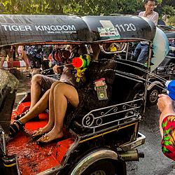 Tuk Tuks are prime targets | Occupants of a tuk tuk getting soaked