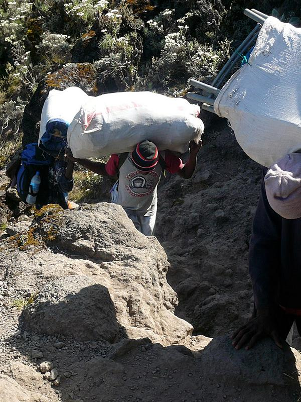 Kilimanjaro Porter with Eskimo Joe's Shirt | Stillwater's jumpin lil juke joint hits Africa.