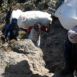 Kilimanjaro Porter with Eskimo Joe's Shirt   Stillwater's jumpin lil juke joint hits Africa.
